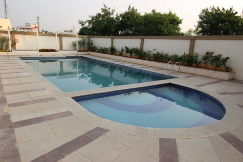 Affordable flats and independent villas by modi properties - Swimming pool construction cost in hyderabad ...